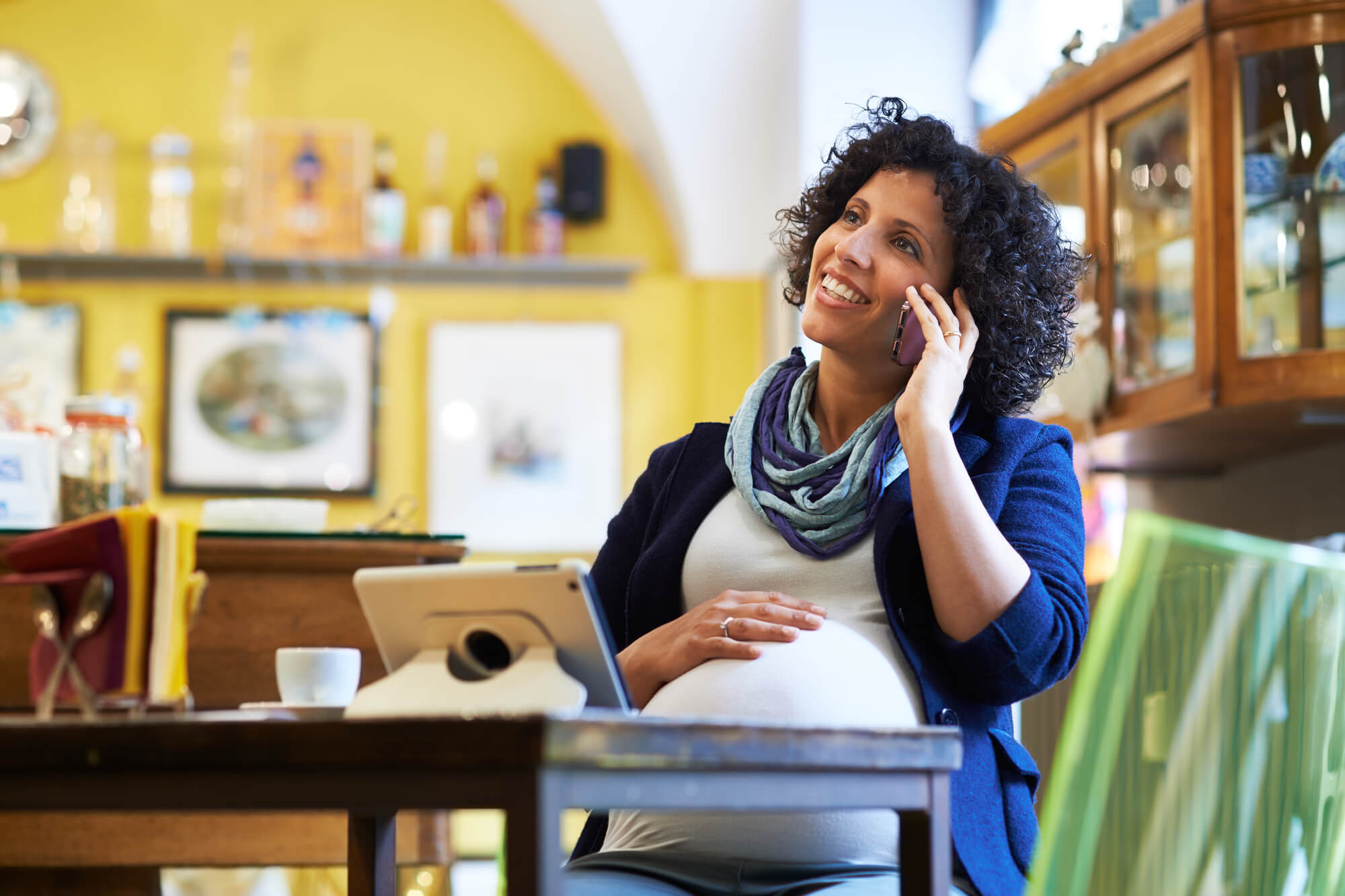 pregnant woman on the phone. Building your birth team