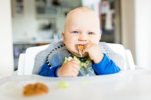 baby feeding himself in high chair baby led weaning